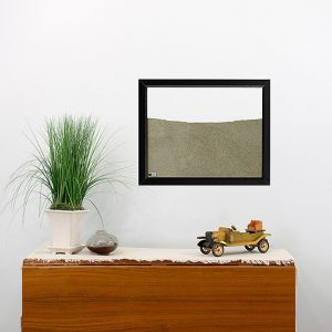 black painted wood frame ant farm hanging on wall