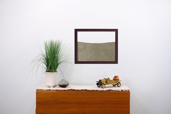brown painted wood frame ant farm hanging on wall