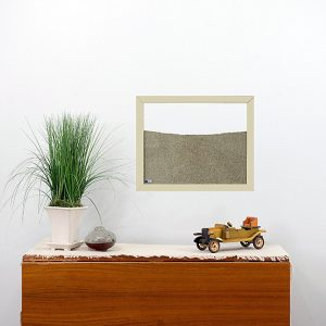 cream painted wood frame ant farm hanging on wall