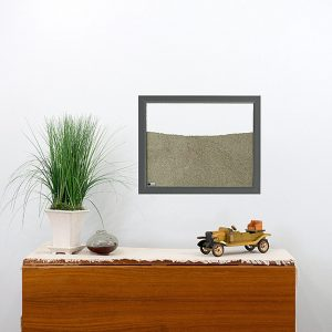 dark grey painted wood frame ant farm hanging on wall