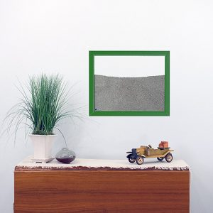 green painted wood frame ant farm hanging on wall
