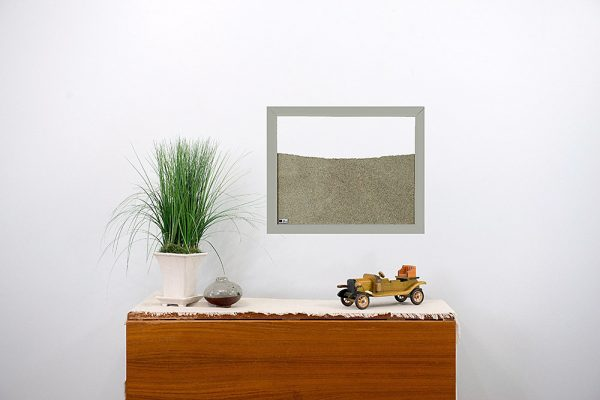 light grey painted wood frame ant farm hanging on wall