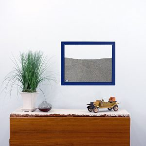 navy painted wood frame ant farm hanging on wall