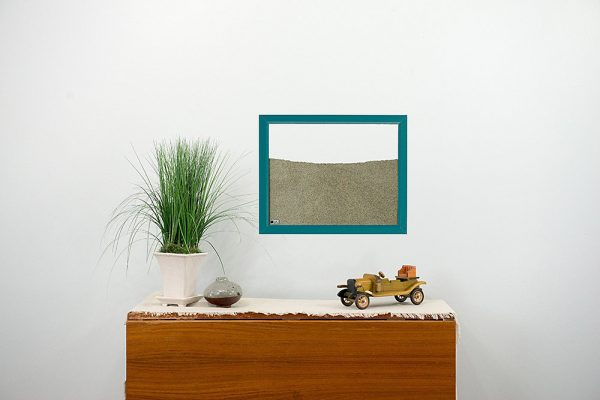 teal wood frame ant farm hanging on wall
