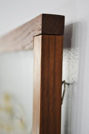 walnut natural wood frame ant farm hanging on wall close up