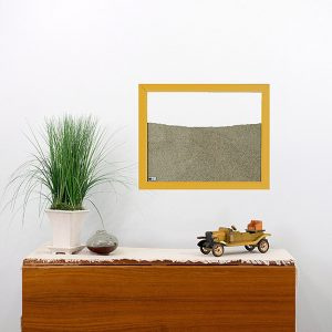 yellow wood frame ant farm hanging on wall