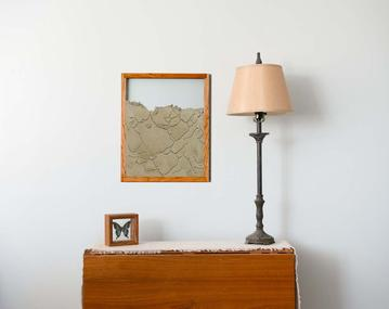 cherry wood frame ant farm hanging on wall